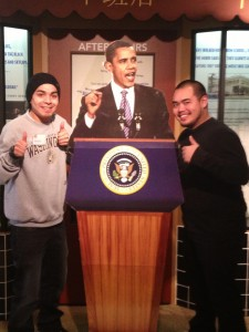 Andres Valdovinos and Muhamed Manhsour pose with Obama cutout.