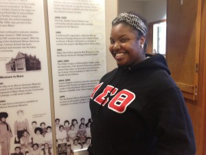 Sierra Stewart welcomes visitors into the museum.