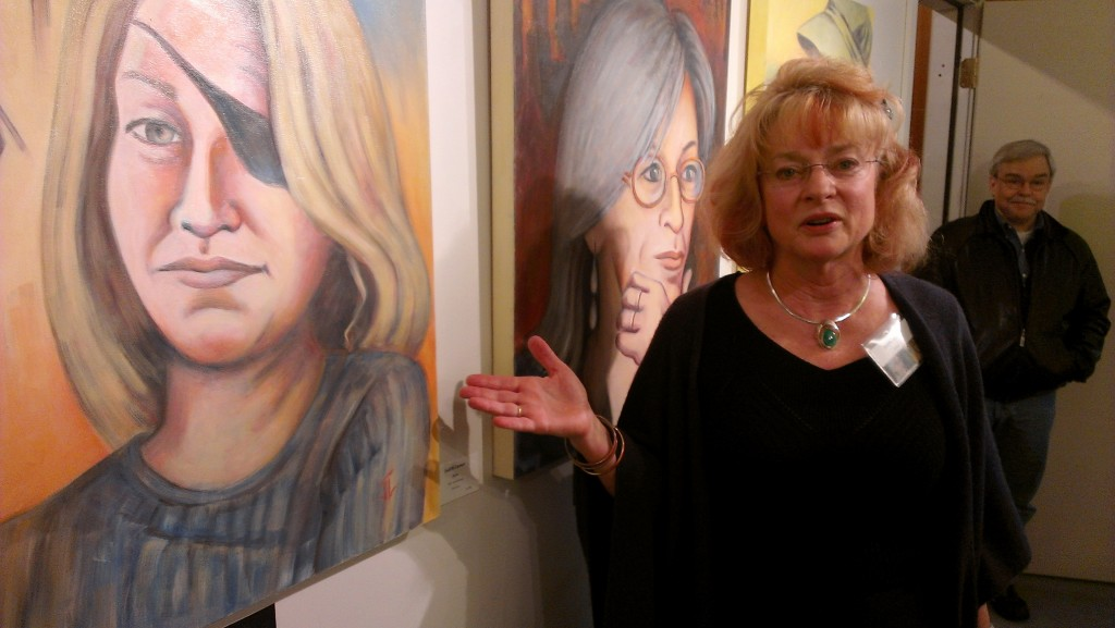 Judith Larsen explaining painting of Marie Colvin.