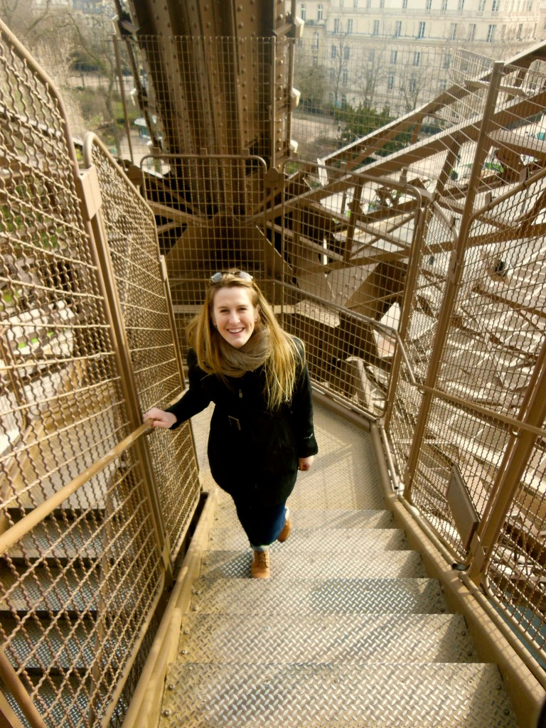 McKenna climbing the steps of the Eiffel Tower in Paris at the end of her trip.