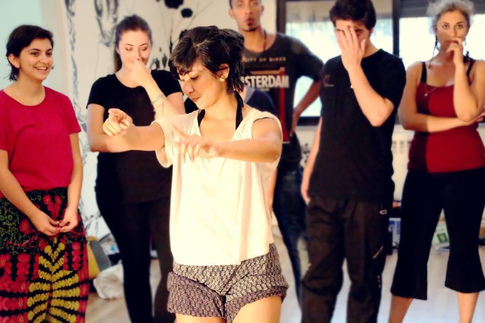Imana teaches a dance class