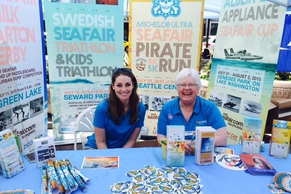 Delaney (L) working a booth at Seafair.