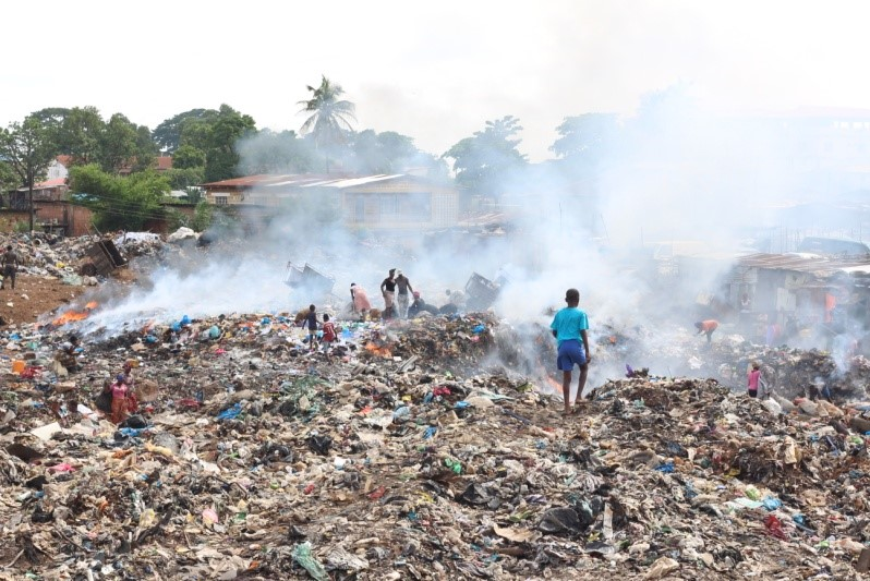 Trash burning and scavenging at one of the city's two main dump sites.